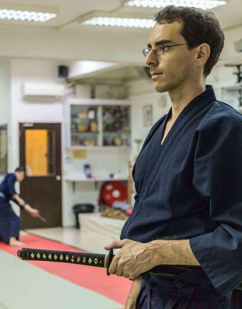 Nicolas Escoffier practicing meditation during iaido japanese sword martial art in singapore sekai dojo