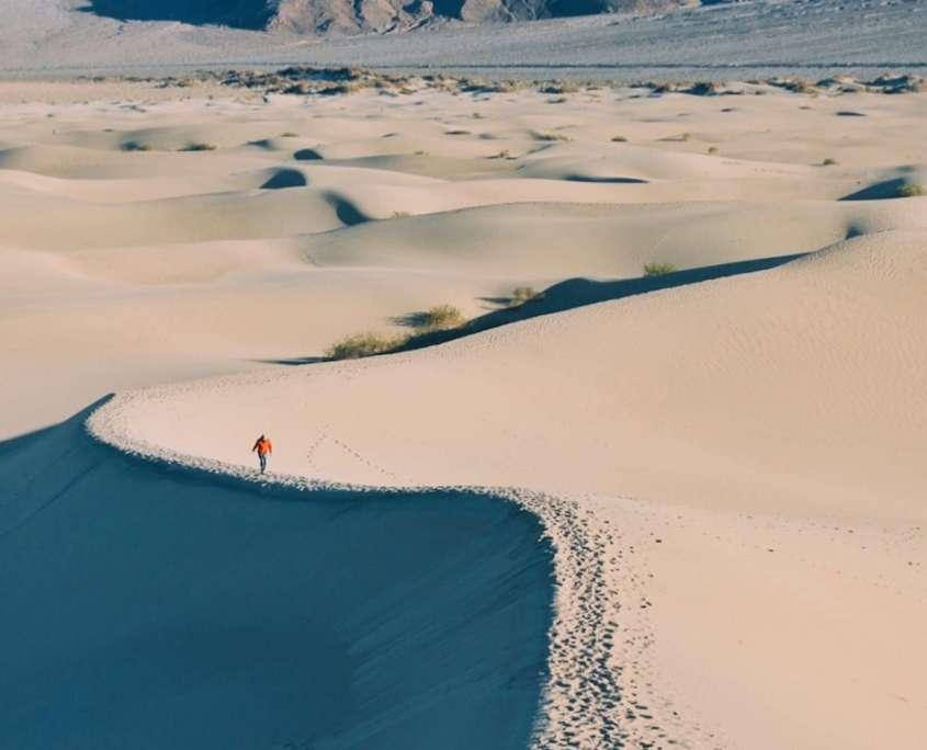 hiker on a meditative walk in a contemplative and calm desert landscape