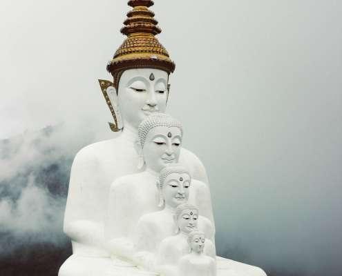 white buddha statue representing the deep level meditative concentration or jhanas
